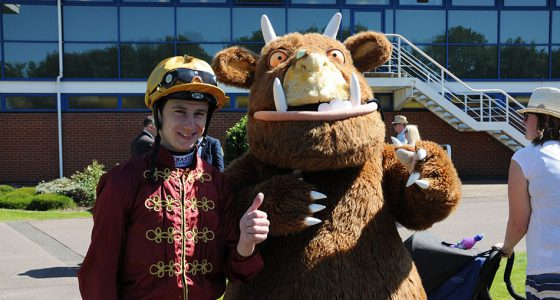 "Oisin Murphy with the Nottingham Gruffalo on Nottingham Family Fun Day. 12/8/2016 Pic Steve Davies/Racingfotos.com  THIS IMAGE IS SOURCED FROM AND MUST BE BYLINED ""RACINGFOTOS.COM"""
